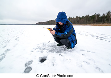 Happy winter fishing in a lake - Ice fishing and happy...