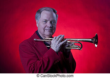 Musician Holding Trumpet on Red
