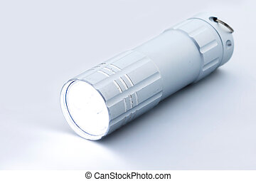Silver flashlight on a white background