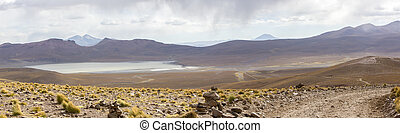 Mountains and salt pan in Eduardo Avaroa Reserve, Bolivia -...