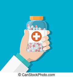 medicine bottle with red cross in hand of a doctor - Doctor...