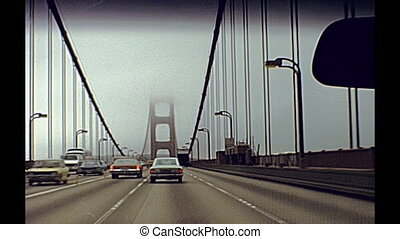 drive through Golden Gate - Vintage point of view of car...