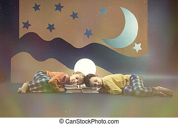 Children dreaming at night with the moon above