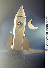 Spaceflight in paper rocket - Boy enjoying the spaceflight...