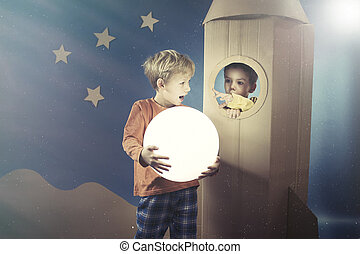 Boy showing the shining ball to his friend