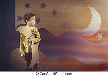 Boy keeping the paper moon - Smiled young boy keeping the...