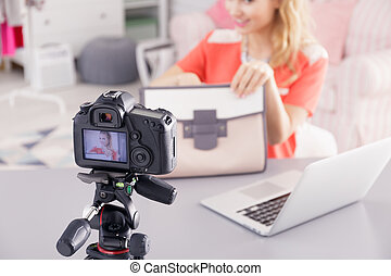 Fashion blogger filming video - Fashion blogger with woman's...