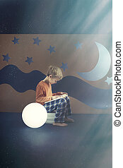 Boy reading a book - Young boy reading a book at night