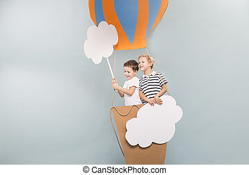 Boys taking a baloon flight - Young and smiled boys taking a...