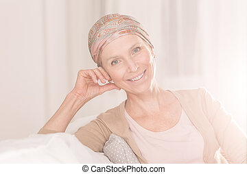 Cancer woman with positive attitude wearing headscarf
