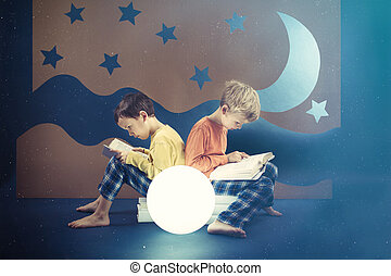 Friends preoccupied by reading books at night