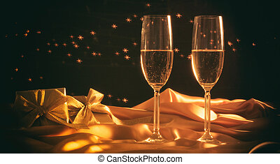 Champagne glasses on stars bokeh background