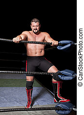professional wrestler in a ring isolated on black