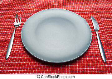 Blue plate and dishware on red napkin