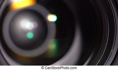 The lens of the camera. Close-up - Lens DSLR camera. Dynamic...