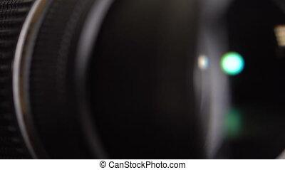 The lens of the camera. Close-up - Lens DSLR camera. Closed...