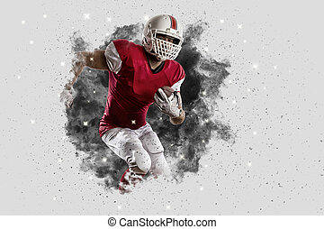 Football Player with a Red uniform coming out of a blast of...
