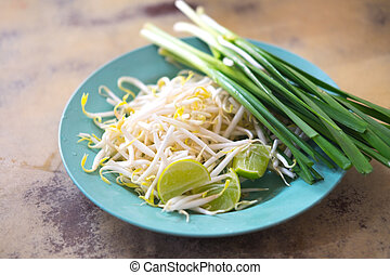 Close up of bean Sprouts and lemon eating with Pad Thai on...