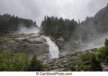 roaring waterfall - beautiful roaring waterfall in mountain