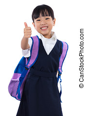 Asian Chinese little primary school girl showing thumbs up -...