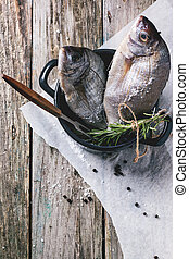 Tow raw fish with rosemary - Top view on tow raw dorado...