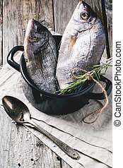 Tow raw fish with rosemary - Tow raw fish bream with...