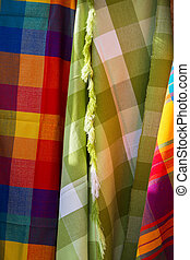 Colorful Fabrics at Otavalo market in Ecuador. - Closeup...