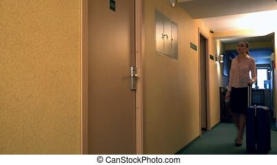 Woman opens the door rooms with electronic key - View of...