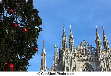 Milan Cathedral and the huge Christmas tree with red and...