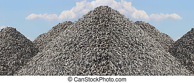Tall Gravel Rock Piles with Bright Blue Sky