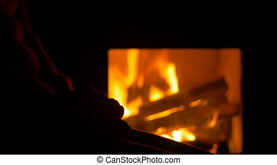 Woman near the Fireplace - Woman in darkness in the lights...
