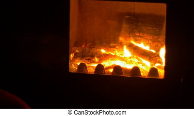 Fire in the Stove - Close up shot of a fireplace.