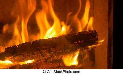 Fire Flames in Stove - Burning wood close up shot inside a...