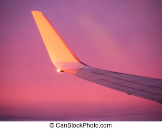 View of the wing aircraft in the sunset