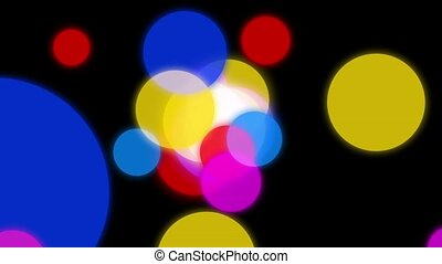 Circles background animation. Colorful circles slowly scatter in different directions on a dark background.