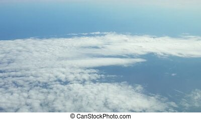 viewpoint Wing of windows airplane flying above the clouds...