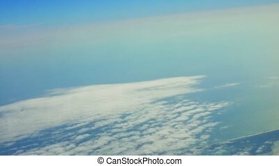 view from the airplane window, ocean blue sky view from the...