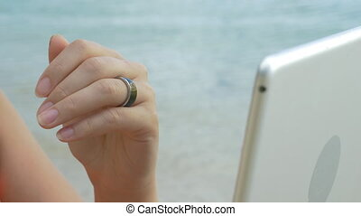 Woman using smart ring to control computer - Close-up shot...