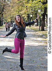 Young woman jumping in nature - Happy young woman jumping in...