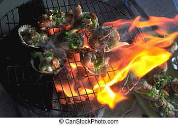 Grilling shellfish and seafood on hot fire