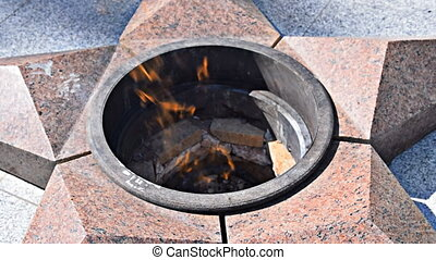 Burning of eternal fire. Five-pointed star made of granite...