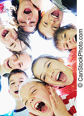 child group - happy child group smilling together and hold...