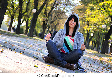 brunette Cute young woman sitting in nature - brunette Cute...
