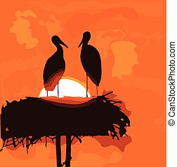 Pair of storks silhouettes in the nest