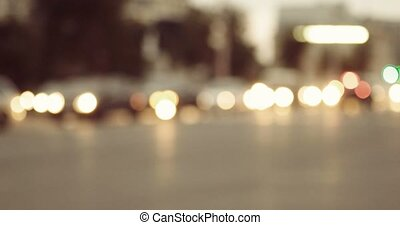Evening lights of city with moving cars