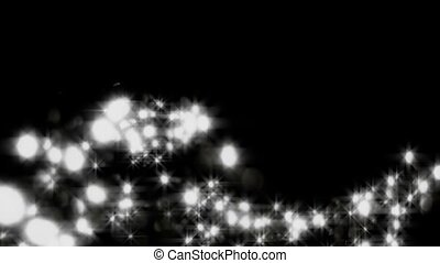 Spots of light fly in an air on dark background.