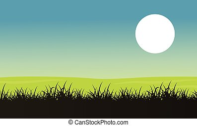 Silhouette of grass with moon landscape
