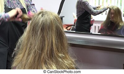 hairdresser brush and shearing hair to woman in parlour. 4K...