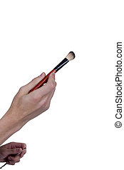 Brush for greasepaint in her hand - Brush for greasepaint in...