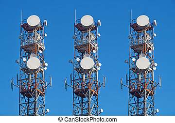 Telecommunication tower with antennas blue sky